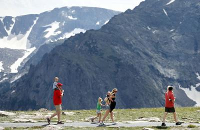 FILE - Family hikes in Colorado