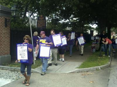 FILE - Local 668 of the Service Employees International Union protest
