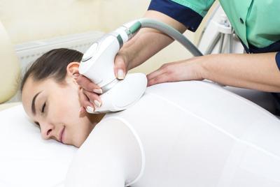 FILE - Massage therapist