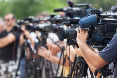 FILE - Journalists reporters camera crew TV