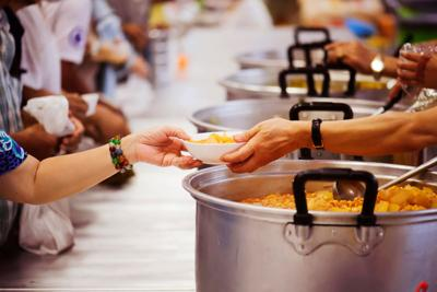 FILE - Soup kitchen hungry poverty