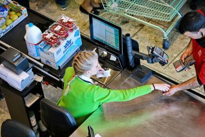 FILE - Cash register retail sales tax