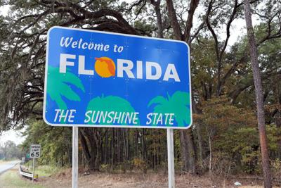 FILE - Florida welcome sign