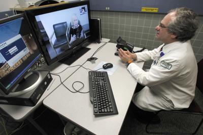 FILE - Remote psychiatry, telemedicine, telehealth