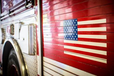 FILE - Fire truck, firefighter