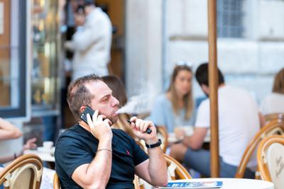 FILE - man vaping, vape, Juul, e-cigarette