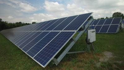 FILE - Solar panel, solar farm