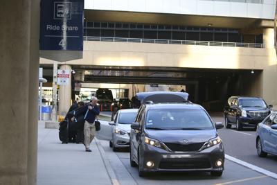 FILE - Phoenix Airport Ride Hailing
