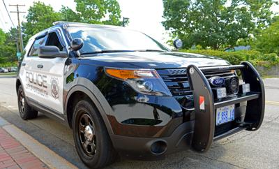 FILE - NH Portsmouth police vehicle 8-18-2014