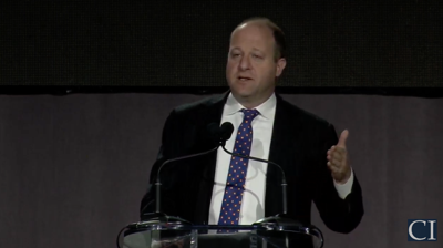 FILE - Colorado Gov. Jared Polis speaks at conservative summit