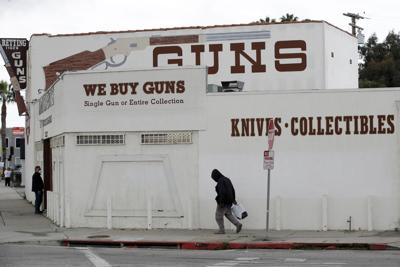 FILE - Guns, knives for sale, 2020, California
