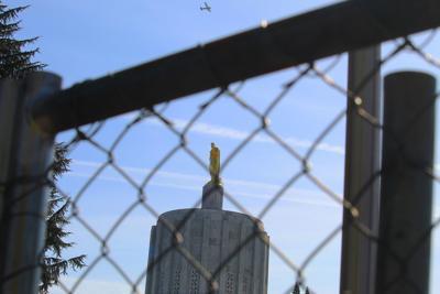 FILE –Oregon capitol building fence