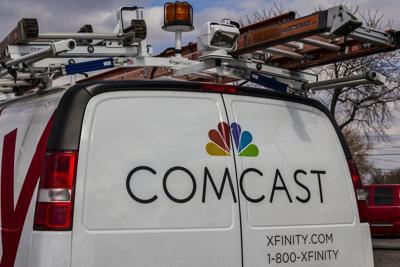 FILE - Comcast Cable/Xfinity service van, ISP, broadband, internet service provider
