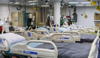 FILE - Hospital beds