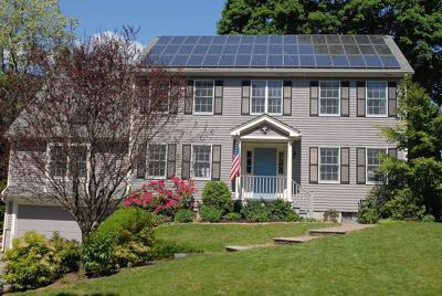 FILE - Solar panel on house roof, solar energy
