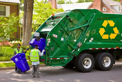 FILE - Recycling bin, recycling truck