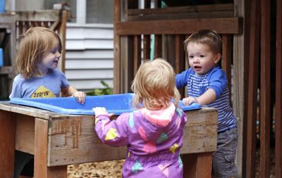 FILE - Children playing