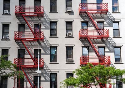 FILE - NY apartment buildings, fire escapes, rental units 7-4-2021