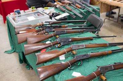 FILE - Rifles at a gun show