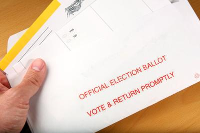 FILE - Mail-in ballot vote by mail