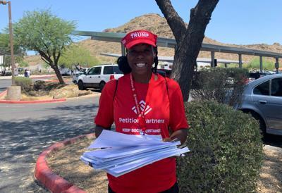 Petition gatherers in MAGA hats at Trump rally