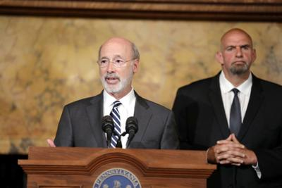 FILE - PA Tom Wolf, John Fetterman 9-25-2019