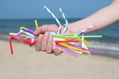 FILE - Plastic straws polluting beach