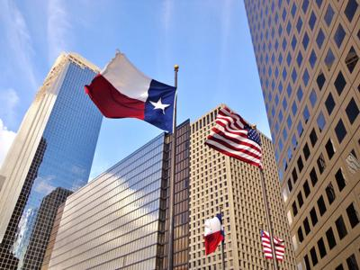 FILE - Downtown Houston Texas flag