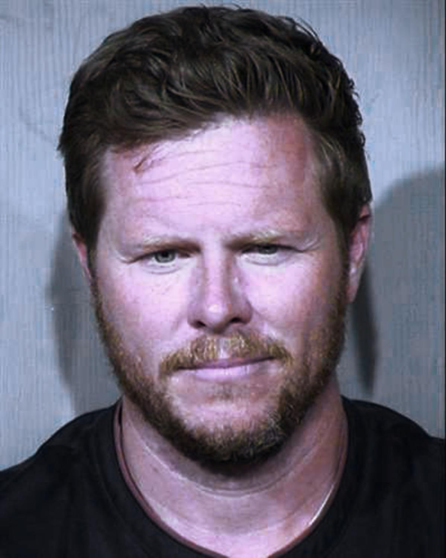 FILE - Arizona Official Adoption Fraud