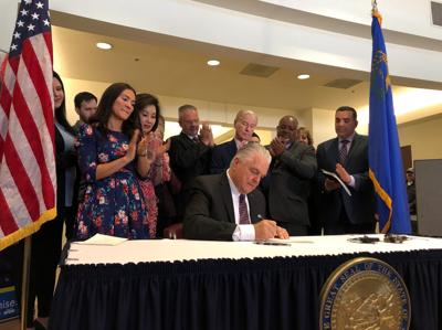 FILE - Nevada Gov. Steve Sisolak signs bills