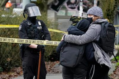 FILE —Seattle cop homeless camp
