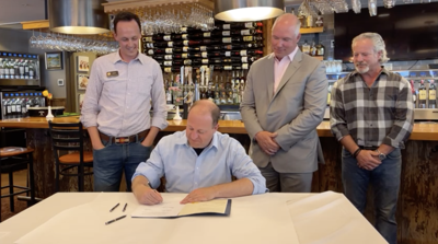 Polis Signs Alcohol To-Go Bill