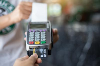 FILE - Credit card purchase debt