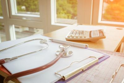 FILE - Health care costs