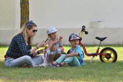 FILE - Family in park children
