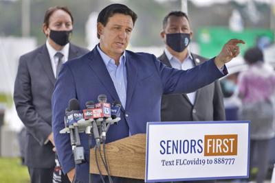 FILE - Florida Gov. Ron DeSantis, Virus Outbreak Florida, 2021