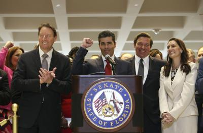 FILE - Florida House speaker Jose Oliva, Senate president Bill Galvano, Gov. Ron Desantis