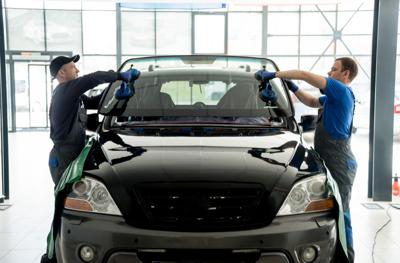 FILE - Car windshield glass