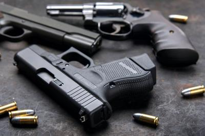 FILE - Handguns
