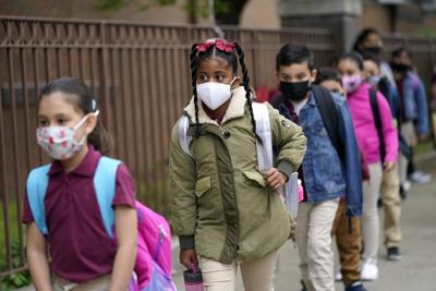 FILE - NJ students, masks 4-29-2021