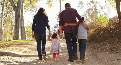 FILE —Family walking