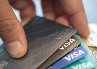 FILE - credit cards, debt