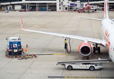 FILE - airport, airplane refueling