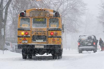 FILE - Winter school bus snow storm