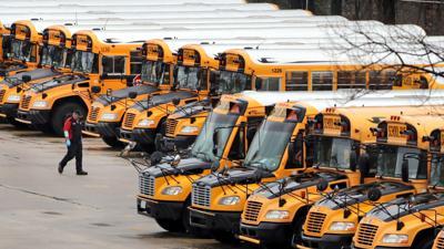 FILE - NH school buses 4-27-2020