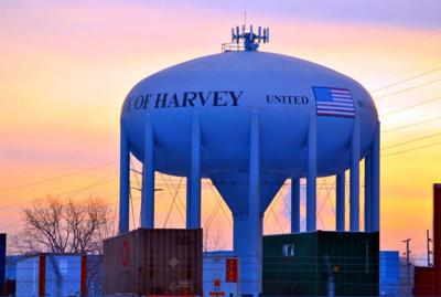 FILE - Harvey, Illinois watertower