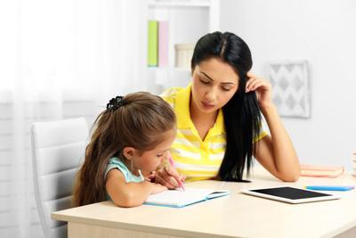 FILE - Home schooling homework