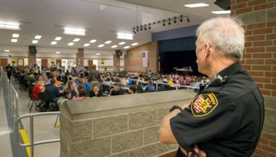 FILE - OH school security officer, Sidney, Ohio 10-6-2014