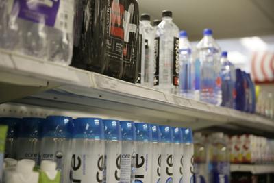 FILE - bottled water, plastic bottles