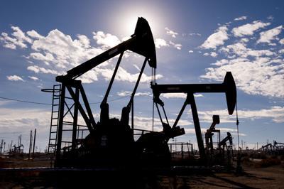 FILE - oil well, fracking, pumpjacks